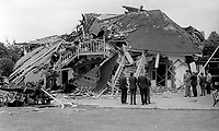 Club members & officials at the scene of Provisional IRA bomb attack which completely destroyed the clubhouse of Belfast Boat Club, N Ireland, August, 1972. 197208000426b<br />