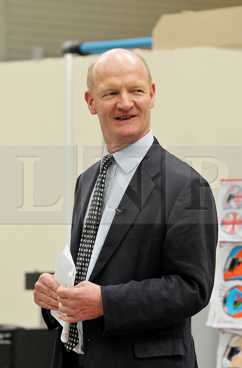 © Licensed to London News Pictures. 04/07/2013. Bristol, UK.  David Willetts, Minister for Science and Universities, speaks at the Bloodhound Supersonic Car project official opening of the new technical centre in Avonmouth, Bristol.  The car is being built to go at 1000mph to break the land speed record, powered by a rocket and a Rolls Royce EJ200 jet engine with a Cosworth engine being used as a pump.  The record attempt will take place in South Africa and Bloodhound will be piloted by Wing Commander Andy Green from the RAF.  David Willetts took part in joining parts of the bodywork together.  04 July 2013.<br /> Photo credit : Simon Chapman/LNP