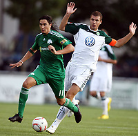 Fotball<br /> 20.07.2010<br /> Foto: Gepa/Digitalsport<br /> NORWAY ONLY<br /> <br /> VfL Wolfsburg vs Panathinaikos Athen<br /> <br /> Bild zeigt Sebastian Leto (Panathinaikos) und Fabian Johnson (Wolfsburg).