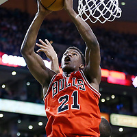 13 February 2013: Chicago Bulls small forward Jimmy Butler (21) grabs the offensive rebound during the Boston Celtics 71-69 victory over the Chicago Bulls at the TD Garden, Boston, Massachusetts, USA.