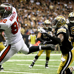 November 6, 2011; New Orleans, LA, USA; Tampa Bay Buccaneers tight end Kellen Winslow (82) catches a touchdown past New Orleans Saints safety Roman Harper (41) during the fourth quarter of a game at the Mercedes-Benz Superdome. The Saints defeated the Buccaneers 27-16. Mandatory Credit: Derick E. Hingle-US PRESSWIRE
