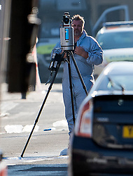 © Licensed to London News Pictures. 19/06/2017. London, UK. A forensics officer uses a camera to record evidence at the scene at Finsbury Park in north London where a van ploughed into a crowd outside Finsbury Park Mosque, as they finished taraweeh, Ramadan evening prayers. Two people are reported to be dead. Photo credit: Ben Cawthra/LNP