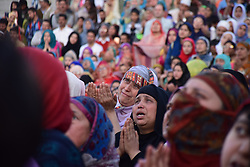 April 14, 2018 - Srinagar, Jammu & Kashmir, India - Kashmiri Women Crying while beseech for blessings as the Holy Relic, Believed to be a hair from the beard of Prophet Mohammed PBUH is being displayed by Holy Priest (not framed) on the occasion of Mehraj-ul-Nabi at Hazratbal shrine in Srinagar, Summer Capital Of Indian Administered Kashmir..Every year thousands of Muslim devotees from across Kashmir gathers at Hazratbal shrine in central Srinagar summer capital of Indian Kashmir for prayers and to watch the Holy Relic (moe-e-moqadas) believed to be a hair from the beard of Prophet Mohammed PBUH, displayed for public on Meraj-ul Alam and other festivals. Mehraj-ul-Alam, A festival which marks the ascension Of Prophet Muhammad PBUH To Heaven. (Credit Image: © Abbas Idrees/SOPA Images via ZUMA Wire)