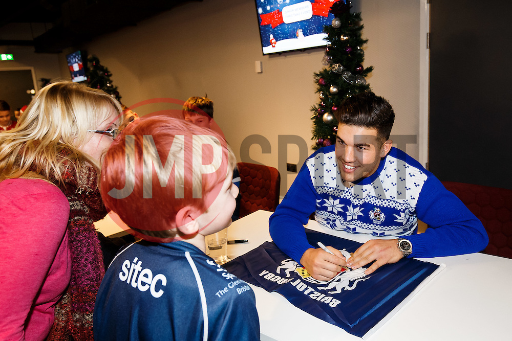 Ben Mosses of Bristol Rugby signs autographs for young fans as Season ticket holders and members of Bristol Sport 7s and Forever Bristol take part in a Bristol Sport Christmas Party - Mandatory byline: Rogan Thomson/JMP - 22/12/2015 - SPORT - Ashton Gate Stadium - Bristol, England - Bristol Sport Christmas at Ashton Gate.