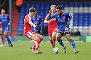 Aaron Amadi-Holloway of Oldham Athletic tries to get past Charlie Raglan of Chesterfield during the Sky Bet League 1 match between Oldham Athletic and Chesterfield at Boundary Park, Oldham, England on 28 March 2016. Photo by Simon Brady.