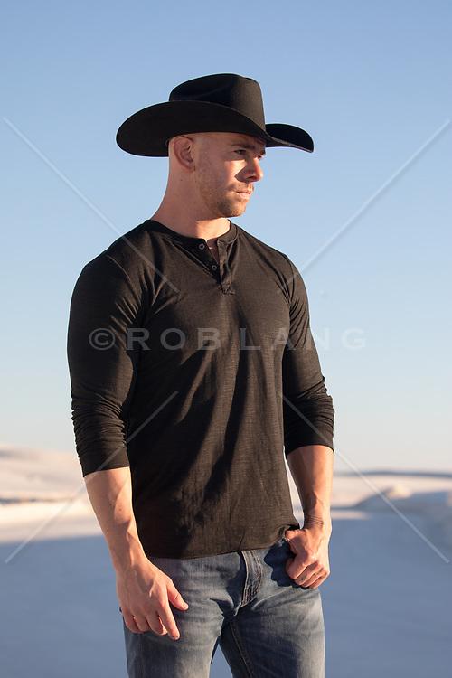 cowboy in a henley shirt at sunset