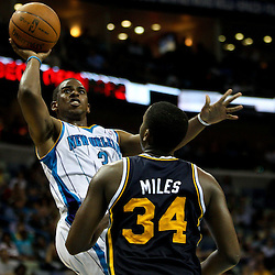 April 11, 2011; New Orleans, LA, USA; New Orleans Hornets point guard Chris Paul (3) shoots over Utah Jazz small forward C.J. Miles (34) during the second half at the New Orleans Arena. The Jazz defeated the Hornets 90-78.  Mandatory Credit: Derick E. Hingle