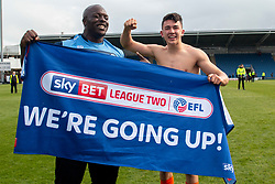 Adebayo Akinfenwa of Wycombe Wanderers and Luke O'Nien of Wycombe Wanderers hold up a Sky Bet banner - Mandatory by-line: Ryan Crockett/JMP - 28/04/2018 - FOOTBALL - Proact Stadium - Chesterfield, England - Chesterfield v Wycombe Wanderers - Sky Bet League Two
