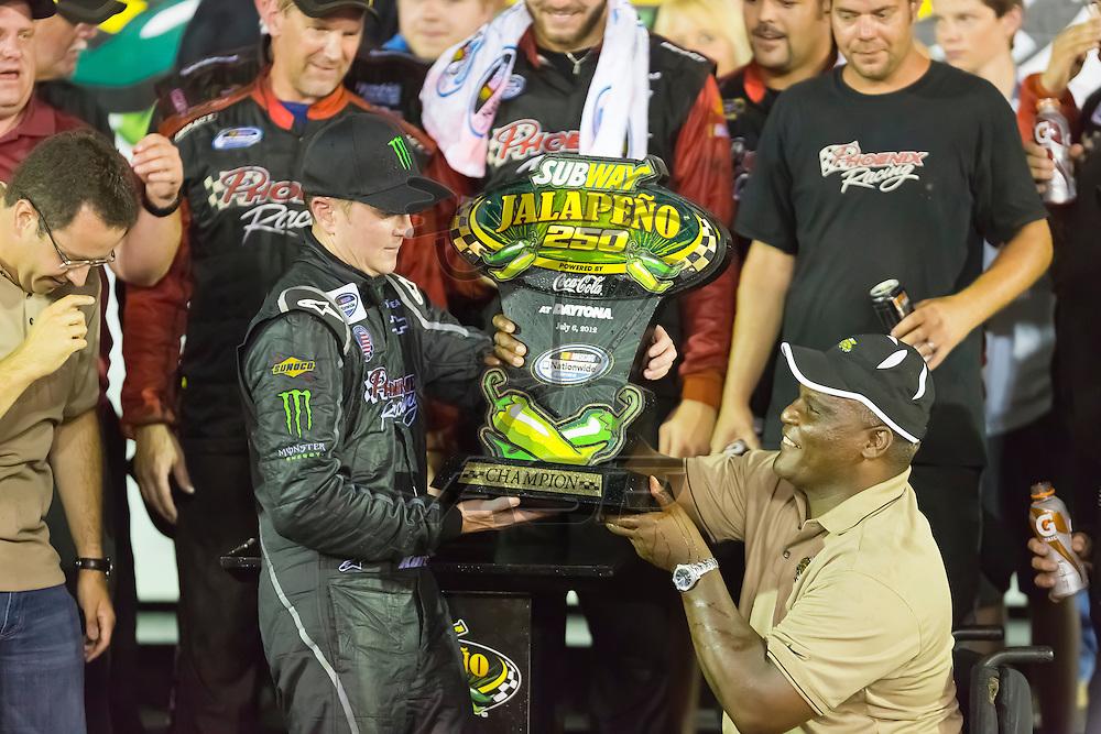 DAYTONA BEACH, FL - JUL 06, 2012:  Kurt Busch (1) holds off the rest of the field to win the Subway Jalapeno 250 at the Daytona International Speedway in Daytona Beach, FL.