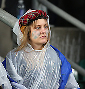 One Scottish fan can't quite believe they have lost during the Rugby World Cup Quarter Final match between Australia and Scotland at Twickenham, Richmond, United Kingdom on 18 October 2015. Photo by Matthew Redman.