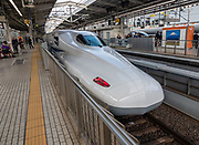 "Kyoto Station, Japan: shinkansen (""new trunkline"") reliable high speed trains are operated by Japan Railways (JR). Running at speeds of up to 320 km/h (200 mph), the shinkansen are Japan's reliable high-speed bullet trains, operated by Japan Railways (JR). The shinkansen, or ""new trunkline"", began with the Tokaido Shinkansen (515.4 km, 320.3 mi) in 1964. As of 2018, the network connects Japan's main islands of Honshu, Kyushu and Hokkaido for 2764.6 kilometers (1717.8 miles) with maximum speeds of 240–320 km/h (150–200 mph). The shinkansen is famous for efficiency, punctuality (often to the second), comfort (relatively silent cars with spacious, always forward facing seats), and safety (no fatal accidents in its history). The Japan Rail Pass (JR Pass) makes the shinkansen a great travel value for foreign tourists in combination with Japan's standard rail network (much cheaper than what Japanese residents pay). The original Tokaido Shinkansen, connecting Japan's three largest cities of Tokyo, Nagoya and Osaka, is one of the world's busiest high-speed rail lines. At peak times, the line carries up to thirteen trains per hour in each direction with sixteen cars each (1323-seat capacity plus standing passengers) with a minimum headway of three minutes between trains. In the one-year period preceding March 2017, it carried 159 million passengers."