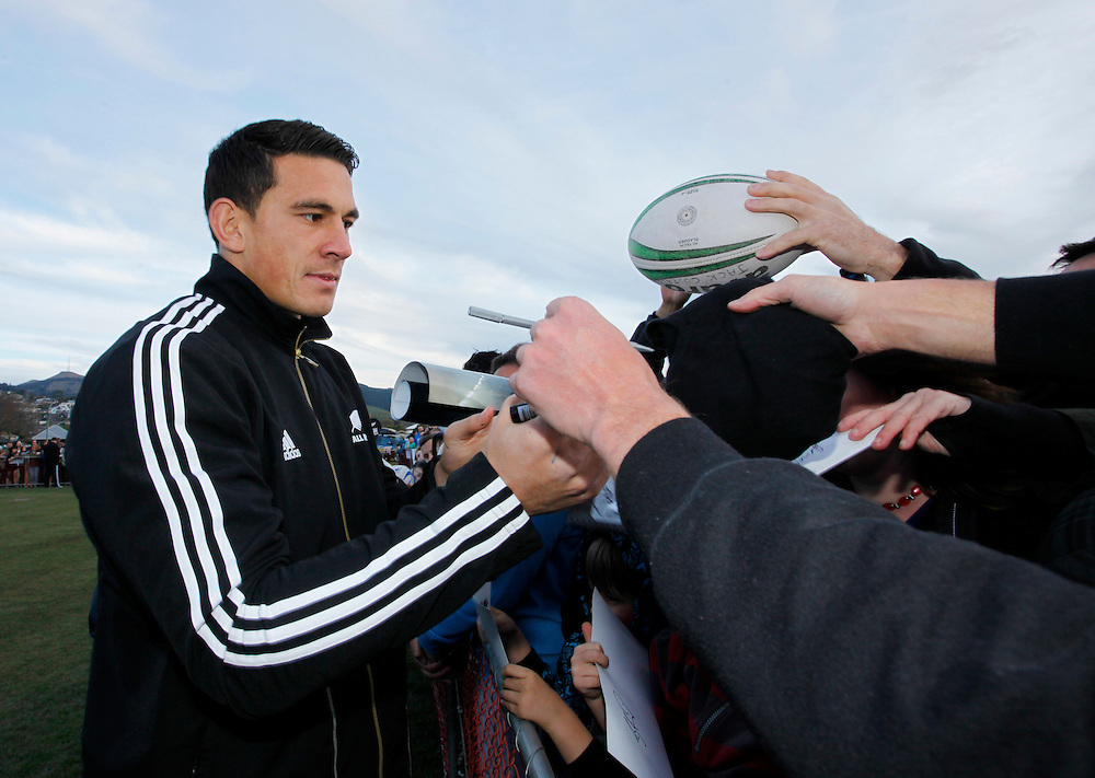 All Black Sonni Bill Williams, left, signing autographs when the New Zealand All Blacks visited Centennial Park, Christchurch, New Zealand, Sunday, September 18, 2011.  Credit:SNPA / Pam Johnson