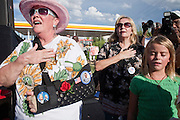 Sept. 10, 2008 -- PHOENIX, AZ: People sing the National Anthem at a Barack Obama campaign rally in Phoenix Wednesday. The Barack Obama presidential campaign opened an office in Phoenix Wednesday just five miles from the home of Republican presidential candidate John McCain. About 400 Obama supporters came the opening.   Photo by Jack Kurtz