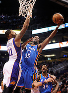Jan. 14, 2013; Phoenix, AZ, USA; Oklahoma City Thunder forward Kevin Durant (35) lays up the ball during the game against the Phoenix Suns forward Markieff Morris (11) in the first half at US Airways Center. The Thunder defeated the Suns 102-90. Mandatory Credit: Jennifer Stewart-USA TODAY Sports.