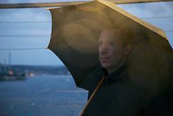 Portrait of Man on Observation Deck under Umbrella