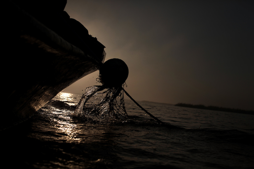 Thomas Gonzales crab fishing in the bayou near Delacroix, LA on November 12, 2010.