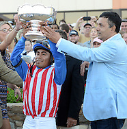 BENSALEM, PA - SEPTEMBER 20: Jockey Martin Garcia (L) and Bayern owner Kaleem Shah hold up the trophy after winning the Pennsylvania Derby September 20, 2014 at Parx Racing in Bensalem Pennsylvania. Bayern set the Parx track record for 1 1/8 miles at 1:46.96. (Photo by William Thomas Cain/Cain Images)