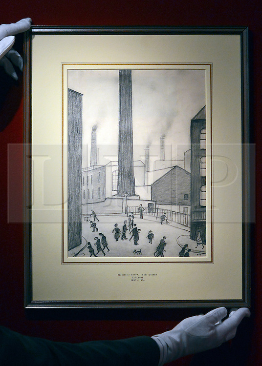 "© Licensed to London News Pictures. 10/01/2013. London, USA. A drawing by Lowry of a ""British Industrial Scene in Oldham""  95,000 GBP. The central chimney was added for a client over dinner. The Mayfair The opening day of The Mayfair Antiques & Fine Art Fair. Items on offer include a selection of antiques and works of art, ranging from period furniture, sculpture, oriental artefacts, silver, clocks, calling card cases, objects of vertu and boxes to paintings, ceramics, glass, jewellery, books, oriental carpets, textiles, prints and decorative items. The fair continues until January 13. Photo credit : Stephen Simpson/LNP."