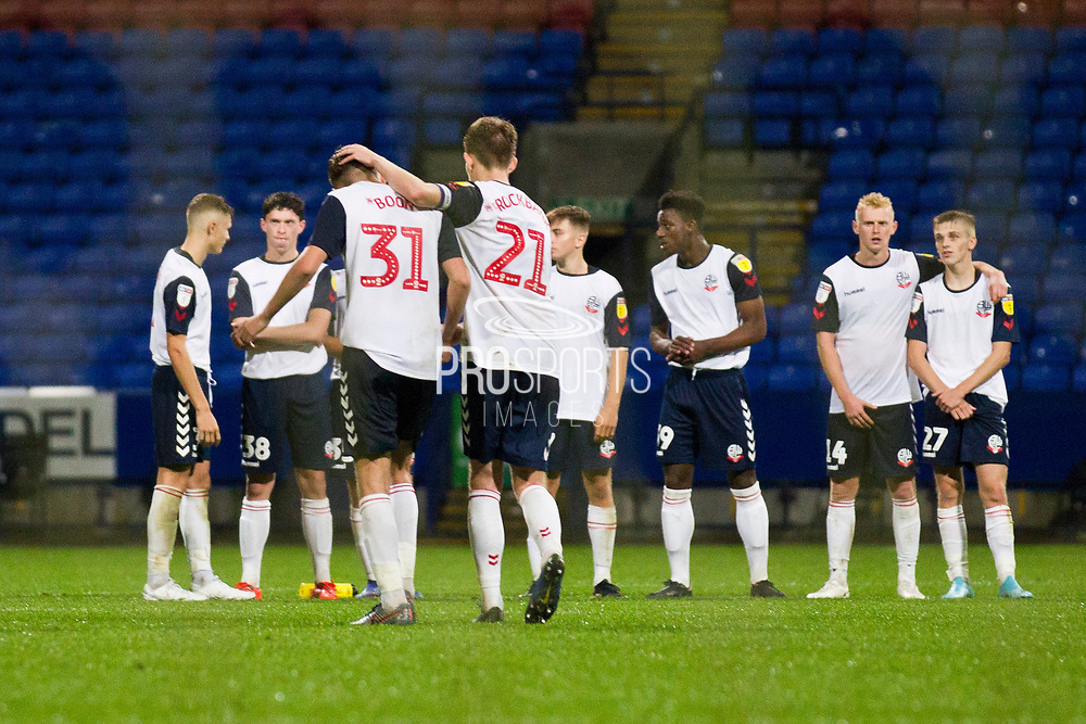 Bolton Wanderers defender Harry Brockbank encourages Bolton Wanderers defender Jordan Boon after missing the goal during the penalty shoot-out during the EFL Trophy match between Bolton Wanderers and Bradford City at the University of  Bolton Stadium, Bolton, England on 3 September 2019.