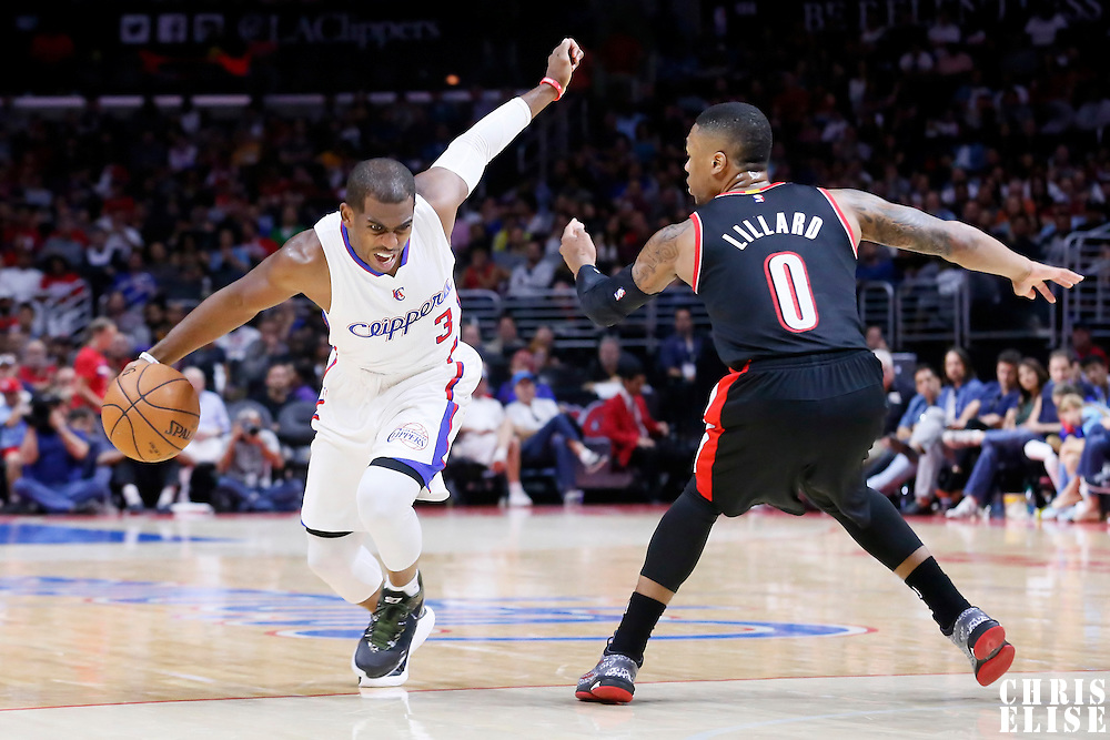 08 November 2014: Los Angeles Clippers guard Chris Paul (3) drives past Portland Trail Blazers guard Damian Lillard (0) during the Los Angeles Clippers 106-102 victory over the Portland Trail Blazers, at the Staples Center, Los Angeles, California, USA.