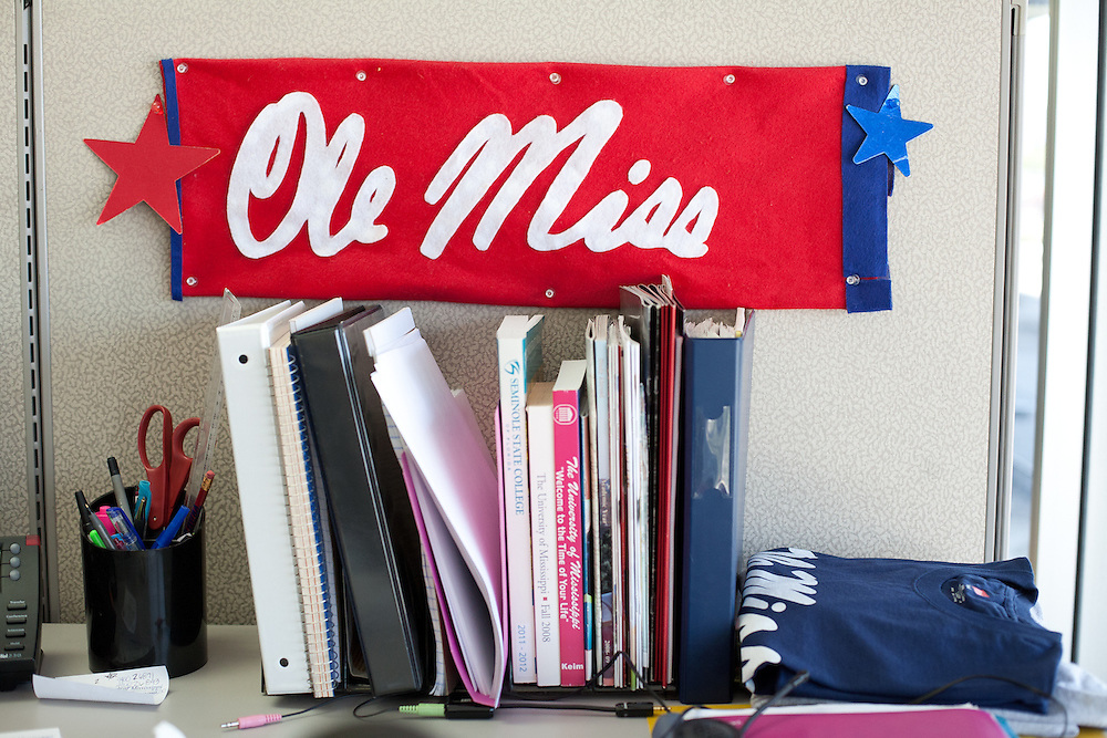"Carrie Benavides has supported callers from Ole Miss for three years and now decorates her office with flags and banners. ""I've become kind of a fan,"" says Benavides of the university's storied football team."
