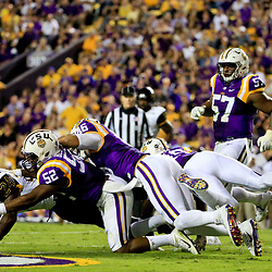 Oct 15, 2016; Baton Rouge, LA, USA;  LSU Tigers linebacker Kendell Beckwith (52) and defensive end Tashawn Bower (46) tackle Southern Miss Golden Eagles running back George Payne (24) during the first half of a game at Tiger Stadium. Mandatory Credit: Derick E. Hingle-USA TODAY Sports