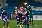 Amari Morgan-Smith heads goalwards during the Vanarama National League match between FC Halifax Town and Cheltenham Town at the Shay, Halifax, United Kingdom on 3 October 2015. Photo by Antony Thompson.