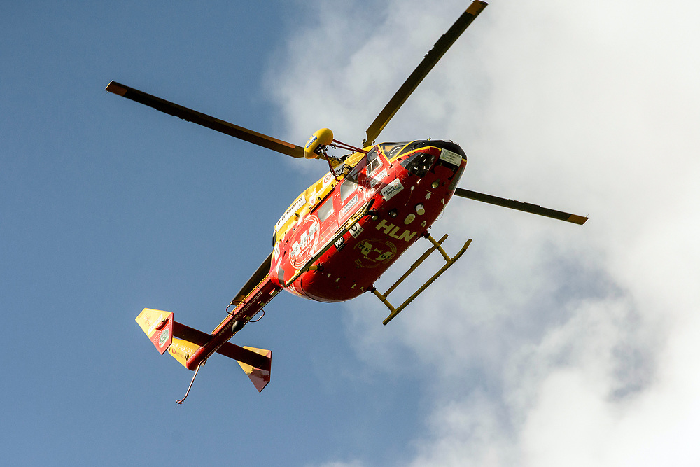 The Westpac rescue helicopter circles as qmed police man a road block on Mt Tiger Road after two women were found dead and a man was taken to hospital with gunshot wounds, with the house at the centre of attention now having been engulfed in fire, Whangarei, New Zealand, Wednesday, July 26, 2017. Credit:SMPA / Malcolm Pullman   **NO ARCHIVING**