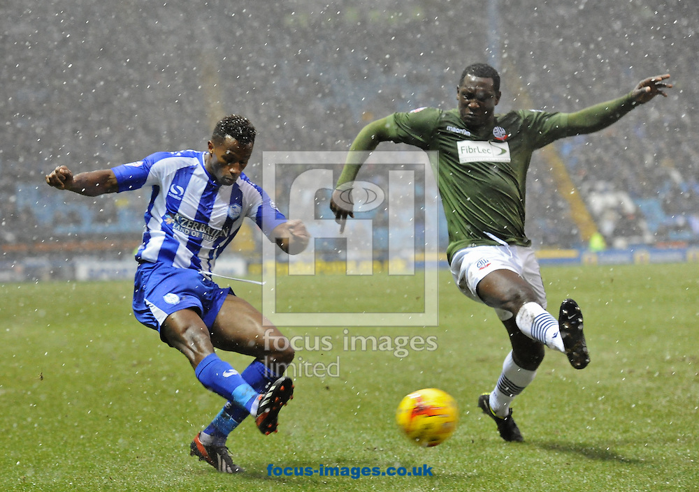 Jose Semedo of Sheffield Wednesday crosses under pressure from Emile Heskey of Bolton Wanderers during the Sky Bet Championship match at Hillsborough, Sheffield<br /> Picture by Richard Land/Focus Images Ltd +44 7713 507003<br /> 17/01/2015