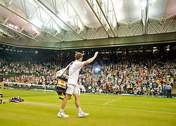 LONDON, ENGLAND - Monday, June 29, 2009: A shattered looking Andy Murray (GBR) waves to the Centre Court crowd as he walks off after his Gentlemen's Singles 4th Round victory on day seven of the Wimbledon Lawn Tennis Championships at the All England Lawn Tennis and Croquet Club. (Pic by David Rawcliffe/Propaganda)