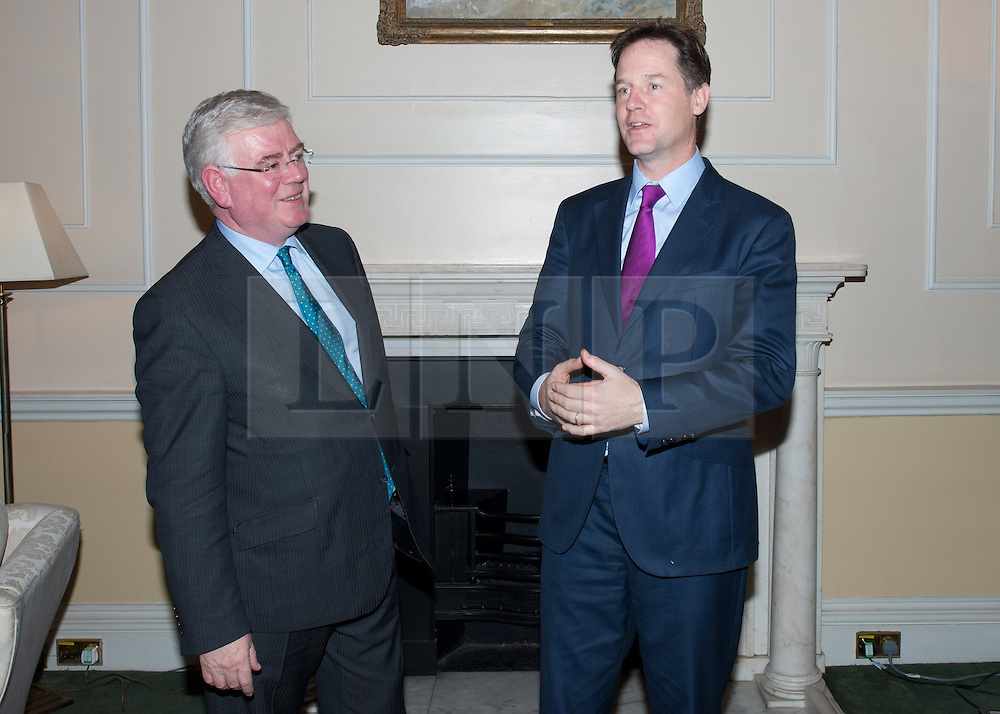 © Licensed to London News Pictures.12/11/2013. London, UK. Nick Clegg, Deputy Prime Minister talks to Eamon Gilmore, Tánaiste (Irish Deputy Prime Minister) during a bilateral meeting at Dover House.Photo credit : Peter Kollanyi/LNP