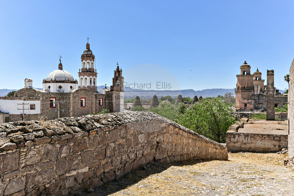 View of the Iglesia de San Diego De Alcalá church, left, and the front towers of the Hacienda de Jaral de Berrio from the old Mescal distillery in Jaral de Berrios, Guanajuato, Mexico. The abandoned Jaral de Berrio hacienda was once the largest in Mexico and housed over 6,000 people on the property.