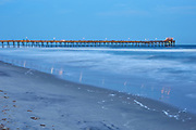 View of the Atlantic Beach fishing pier and ocean waves shortly after sunset in April 2018 (note: fishing pier was damaged by Hurricane Florence less than six months after this photo was taken)
