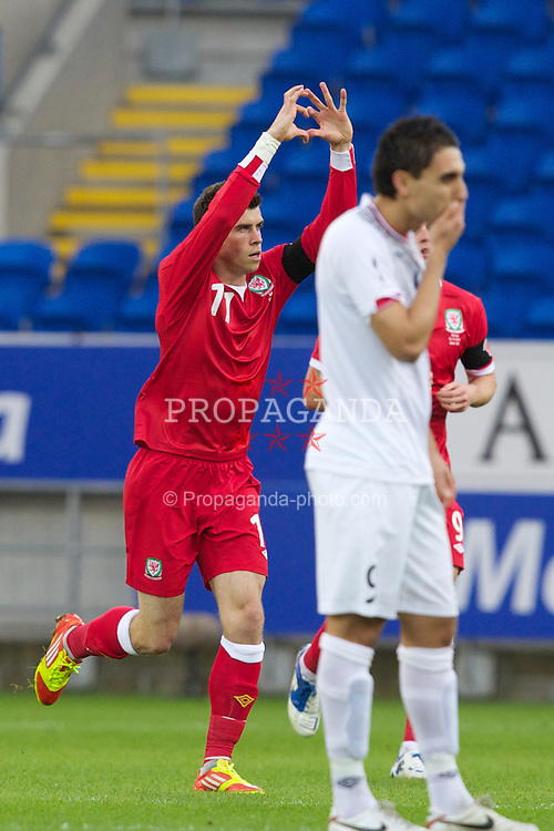 CARDIFF, WALES - Saturday, November 12, 2011: Norway's Mohammed Abdellaoue looks dejected as Wales' Gareth Bale celebrates scoring the first goal during the international friendly match at the Cardiff City Stadium. (Pic by Vegard Grott/Propaganda)