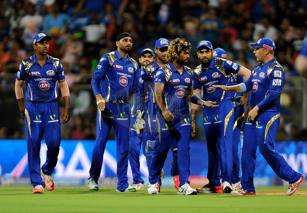 Lasith Malinga of Mumbai Indians is congratulated by teammates after claiming the wicket of David Miller of Kings XI Punjab during match 7 of the Pepsi IPL 2015 (Indian Premier League) between The Mumbai Indians and The Kings XI Punjab held at the Wankhede Stadium in Mumbai, India on the 12th April 2015.<br /> <br /> Photo by:  Pal Pillai / SPORTZPICS / IPL