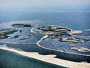 Nederland, Flevoland, Markermeer, 26-08-2019; Marker Wadden in het Markermeer. Overzicht, gezien  naar Houtribdijk en Trintelzand.<br /> Doel van het project van Natuurmonumenten en Rijkswaterstaat is natuurherstel, met name verbetering van de ecologie in het gebied, in het bijzonder de kwaliteit van bodem en water<br /> Naast het hoofdeiland is er inmiddels een tweede eiland in wording, de uiteindelijk Marker Wadden archipel zal uit vijf eilanden bestaan. <br /> Marker Wadden, artifial islands. The aim of the project is to restore the ecology in the area, in particular the quality of soil and water.<br /> The first phase of the construction, the main island, is finished. <br /> <br /> luchtfoto (toeslag op standard tarieven);<br /> aerial photo (additional fee required);<br /> copyright foto/photo Siebe Swart