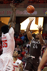 27 November 2015: Godson Eneogwe shoots over Roland Griffin(35). Illinois State Redbirds host the Quincy Hawks at Redbird Arena in Normal Illinois (Photo by Alan Look)