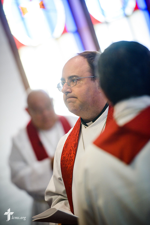 The Rev. Dr. Antonio Lopez, new national missionary pastor at El Calvario Lutheran Church, listens to the Rev. Mark Barz, third vice president of the Texas District and pastor of Crown of Life Lutheran Church, San Antonio, Texas, during the installation service for Lopez on Sunday, July 31, 2016, in Brownsville, Texas. LCMS Communications/Erik M. Lunsford