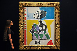 "© Licensed to London News Pictures. 15/06/2017. London, UK. A staff member views ""Femme accroupie"", 1954, by Pablo Picasso (estimate GBP6.5-8.5m).  Preview of Impressionist and Modern art sale, which will take place at Sotheby's New Bond Street on 21 June.  Photo credit : Stephen Chung/LNP"