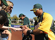 PHOENIX, AZ - FEBRUARY 23:  Michael Choice #32 of the Oakland Athletics signs autographs for fan prior to the spring training game against the Milwaukee Brewers at Maryvale Baseball Park on February 23, 2013 in Phoenix, Arizona.  (Photo by Jennifer Stewart/Getty Images) *** Local Caption *** Michael Choice