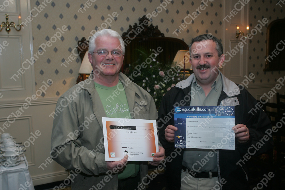 Pictured at the Presentation of Certs in Basic Computer Course by the Irrickane Network were Joe Clancy and Raymond Ward.<br />Pic.Brian Gavin/Press 22