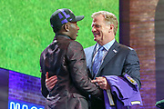 Apr 25, 2019; Nashville, TN, USA; Oklahoma wide receiver Marquise Brown  poses with NFL commissioner Roger Goodell after being selected as the No. 25 pick of the first round by the Baltimore Ravens during the 2019 NFL Draft. (Kim Hukari/Image of Sport)