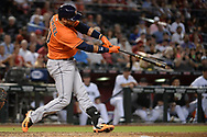PHOENIX, AZ - AUGUST 15:  Yuli Gurriel #10 of the Houston Astros hits an RBI triple in the fourth inning against the Arizona Diamondbacks at Chase Field on August 15, 2017 in Phoenix, Arizona.  (Photo by Jennifer Stewart/Getty Images)