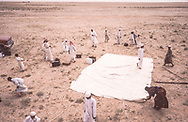 Preparing to setup the school tent, Southeastern Saudi Arabia.