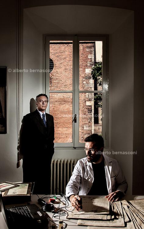 Milan, Brera, Biblioteca Braidense, Archicio Ricordi. Restorer paolo Crisostomi and his assistant Marco Biasiotti doing diagnosis on a ancient manuscript
