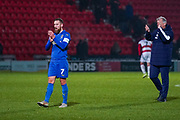 AFC Wimbledon midfielder Scott Wagstaff (7) claps the away fans during the The FA Cup match between Doncaster Rovers and AFC Wimbledon at the Keepmoat Stadium, Doncaster, England on 19 November 2019.