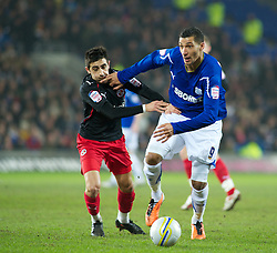 CARDIFF, WALES - Tuesday, February 1, 2011: Cardiff City's Jay Bothroyd and Reading's Jem Karacan in action during the Football League Championship match at the Cardiff City Stadium. (Photo by Gareth Davies/Propaganda)