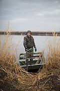 Phil Jackson, a longtime muskrat trapper, heads out to set traps in Blackwater National Wildlife Refuge. Jackson says the number of muskrats have declined since the salinity of the water in the marsh has climbed, a result of sea level rise. Feb. 19, 2014.