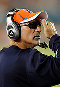 Miami Dolphins head coach Tony Sparano wipes his brow on a humid night during the NFL week 1 football game against the New England Patriots on Monday, September 12, 2011 in Miami Gardens, Florida. The Patriots won the game 38-24. ©Paul Anthony Spinelli