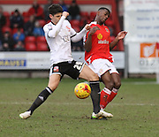 Raphael Rossi-Branco fouls Greg Leigh during the Sky Bet League 1 match between Crewe Alexandra and Swindon Town at Alexandra Stadium, Crewe, England on 28 February 2015. Photo by Andrew Morfett.